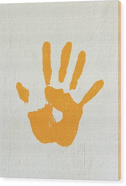 Orange Handprint On A Wall Wood Print
