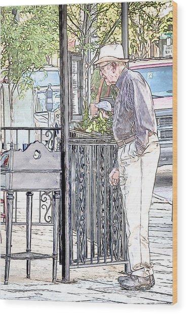 Perusing The Menu Wood Print by John Haldane