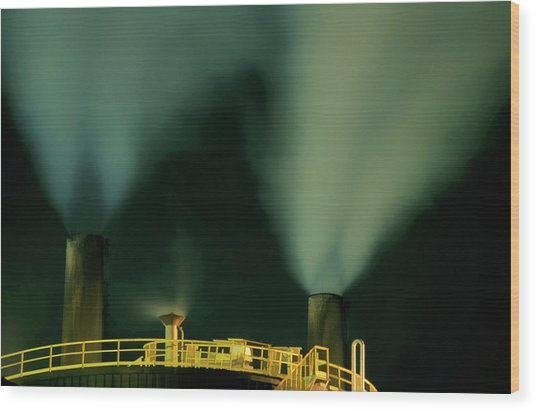 Petroleum Refinery Chimneys At Night Wood Print by Sami Sarkis