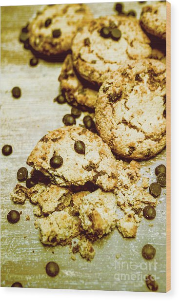 Pile Of Crumbled Chocolate Chip Cookies On Table Wood Print