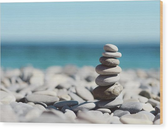 Pile Of Stones On Beach Wood Print