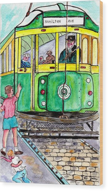 Placing Bottle Caps On The Trolley Tracks Wood Print