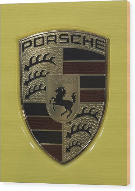 Porsche Emblem On Racing Yellow Wood Print