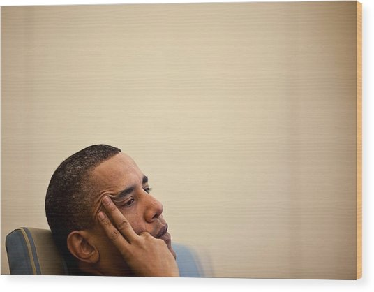 President Barack Obama Listening Wood Print by Everett
