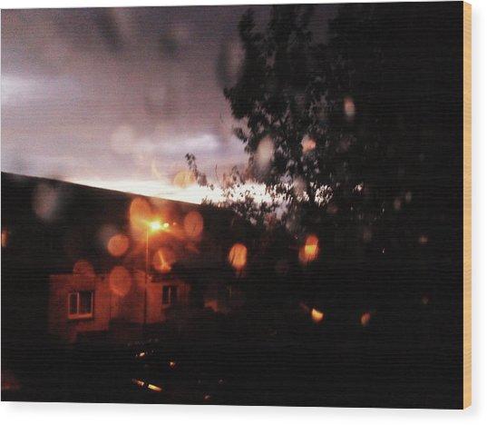 Rainy Sunset Wood Print by Chrisselle Mowatt
