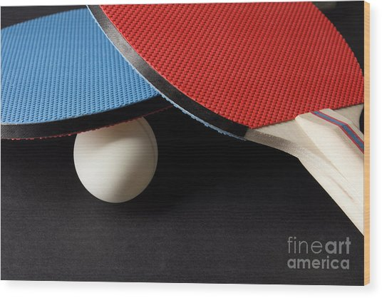 Red And Blue Ping Pong Paddles - Closeup On Black Wood Print