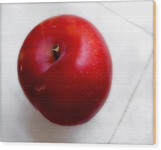 Red Plum On A White Cloth Wood Print