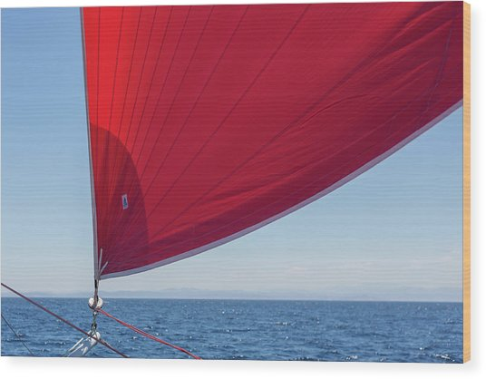 Wood Print featuring the photograph Red Sail On A Catamaran 2 by Clare Bambers