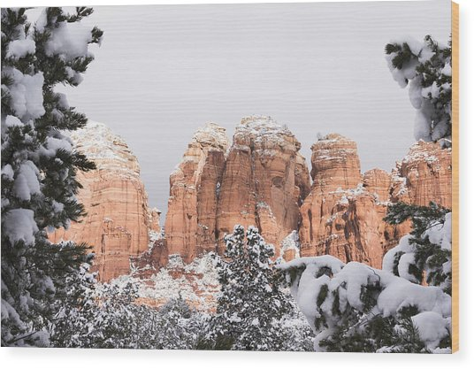 Red Towers Under Snow Wood Print