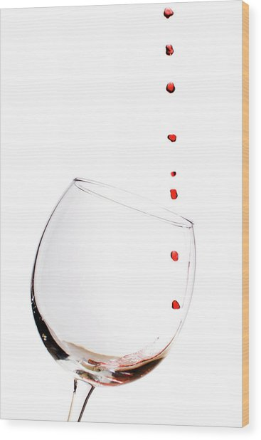 Red Wine Drops Into Wineglass Wood Print
