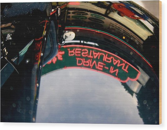 Reflected Neon Sign In Car Hood Wood Print