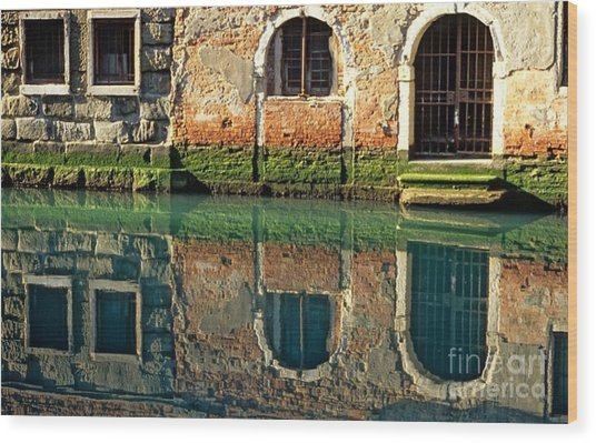 Reflection On Canal In Venice Wood Print by Michael Henderson