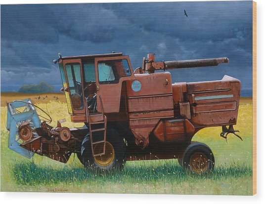 Retired Combine Awaiting A Storm Wood Print by Doug Strickland