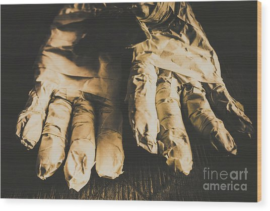 Rising Mummy Hands In Bandage Wood Print