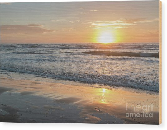 Rising Sun Reflecting On Wet Sand With Calm Ocean Waves In The B Wood Print