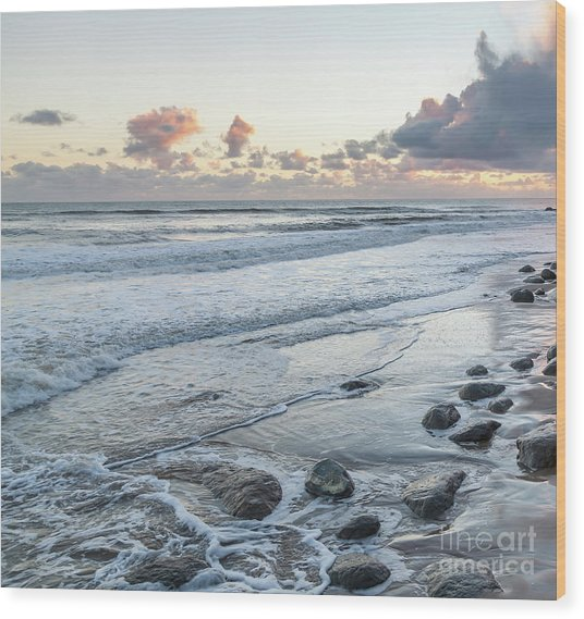 Rocks On The Beach During Sunset Wood Print