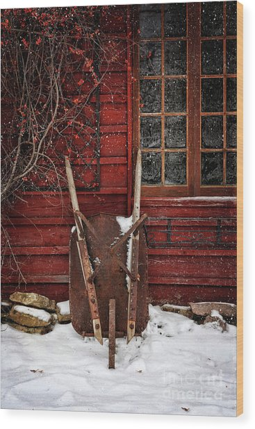 Rusty Wheelbarrow Leaning Against Barn In Winter Wood Print