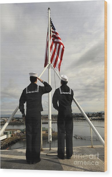 Wood Print featuring the photograph Sailors Raise The National Ensign by Stocktrek Images