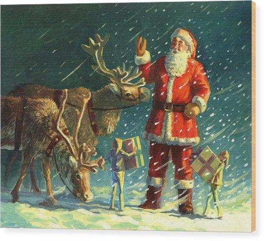 Santas And Elves Wood Print