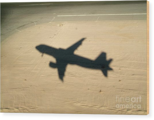 Shadow Of Airplane Flying Into Land Wood Print by Sami Sarkis