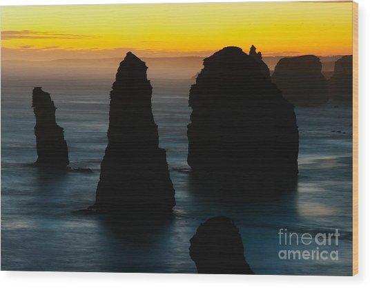 Silhouette Of The Twelve Apostles At Sunset Wood Print by Hideaki Sakurai
