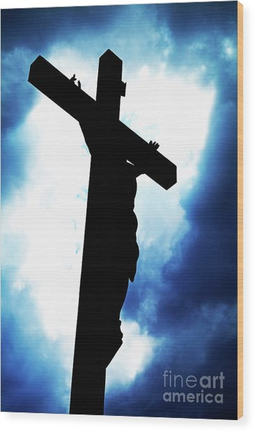 Silhouetted Crucifix Against A Cloudy Sky Wood Print by Sami Sarkis