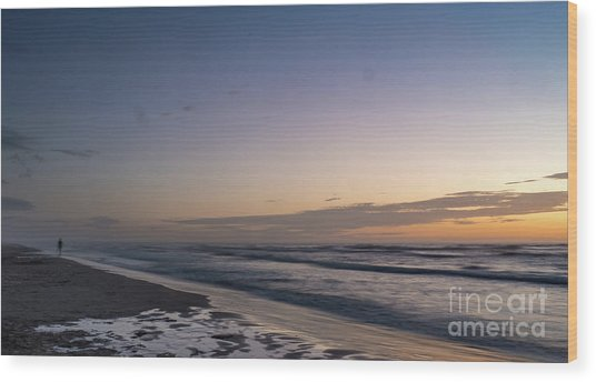 Single Man Walking On Beach With Sunset In The Background Wood Print