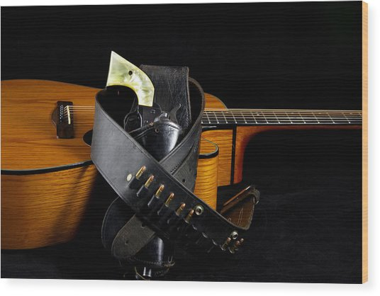 Six Gun And Guitar On Black Wood Print