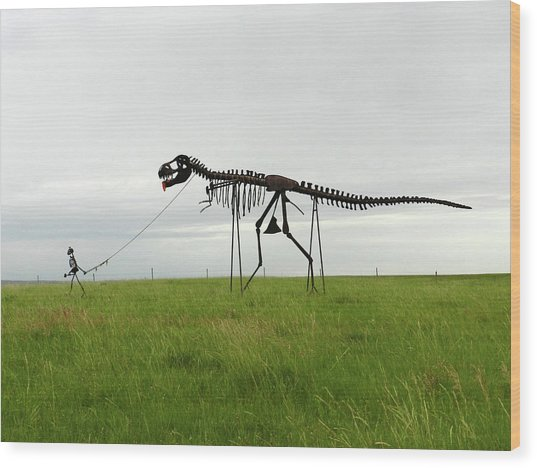 Skeletal Man Walking His Dinosaur Statue Wood Print