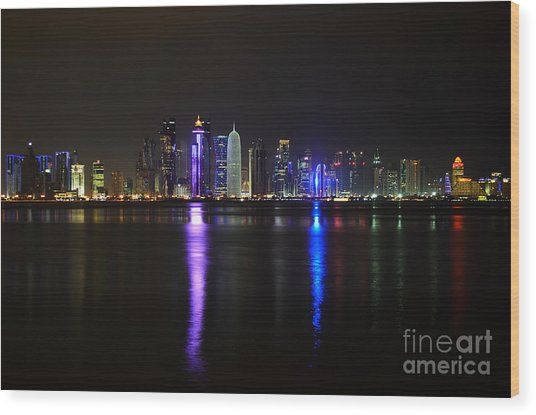 Skyline Of Doha, Qatar At Night Wood Print
