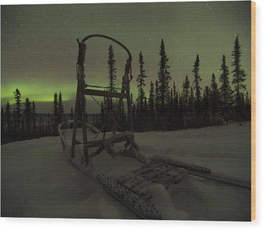 Sled Skeleton Aurora Wood Print