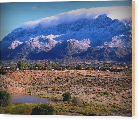 Snow Covered Mountains Above The Pond Wood Print