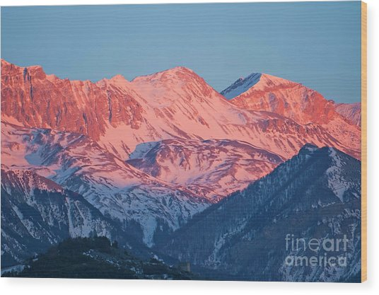 Snowy Mountain Range With A Rosy Hue At Sunset Wood Print by Sami Sarkis