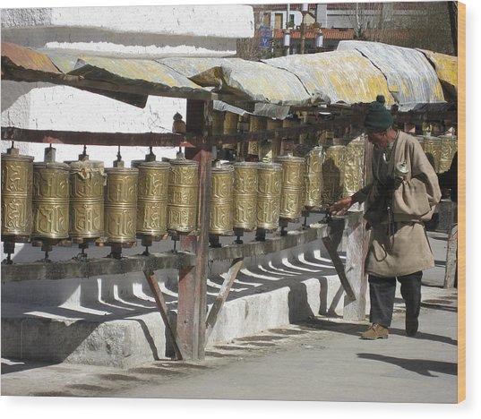 Spinning The Prayer Wheels In Lhasa  Wood Print by James Lukashenko