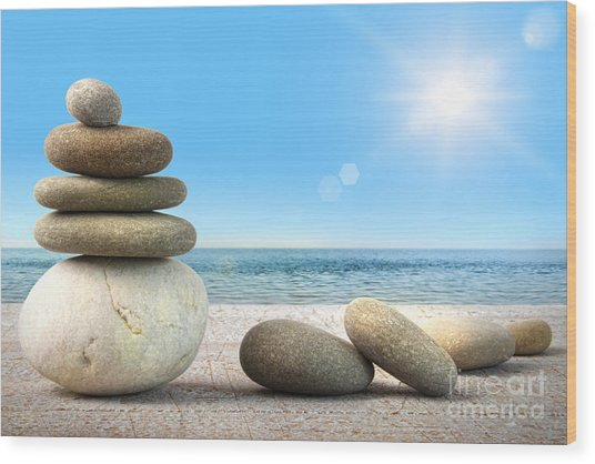 Stack Of Spa Rocks On Wood Against Blue Sky Wood Print