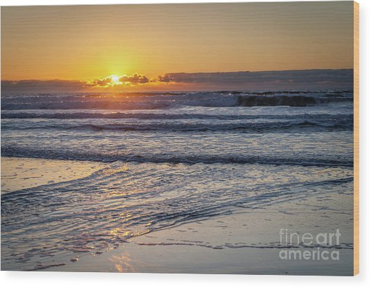 Sun Behind Clouds With Beach And Waves In The Foreground Wood Print