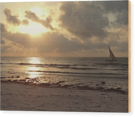 Sun Rays On The Water With Wooden Dhow Wood Print