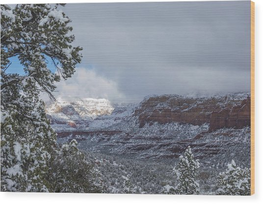 Sunlit Snowy Cliff Wood Print