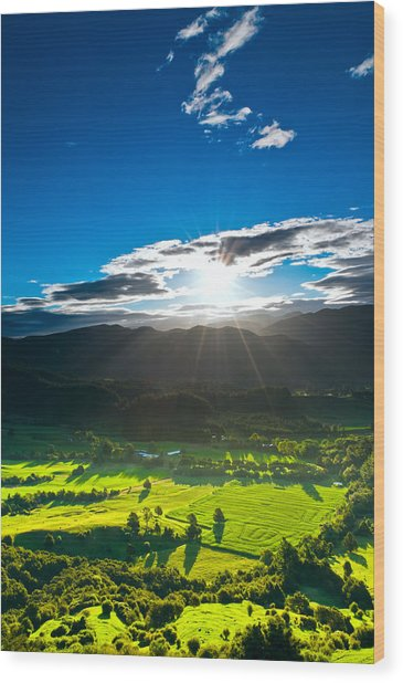 Sunrays Flood Farmland During Sunset Wood Print