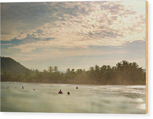 Sunrise Surfers Wood Print