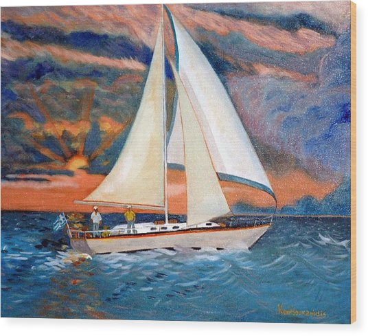Sunset And Yacht Wood Print by Kostas Koutsoukanidis