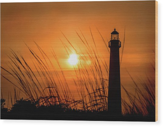 Sunset At Cm Lighthouse Wood Print