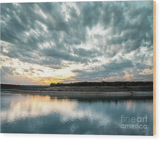Sunset Behind Small Hill With Storm Clouds In The Sky Wood Print
