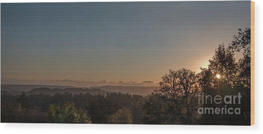 Sunset Behind Tree With Forest And Mountains In The Background Wood Print