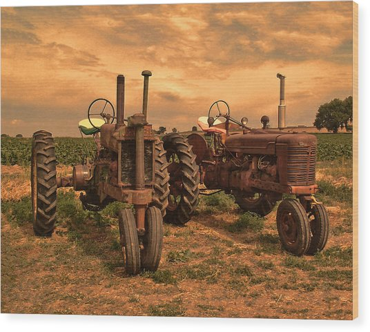 Sunset On The Tractors Wood Print