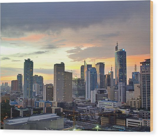 Sunset Over  Makati City, Manila Wood Print by Neil Howard
