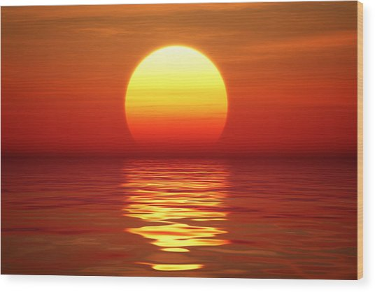 Sunset Over Tranqual Water Wood Print