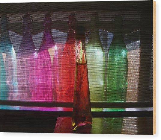 Sunset Through Glass Bottles Wood Print by Adrianne Wood