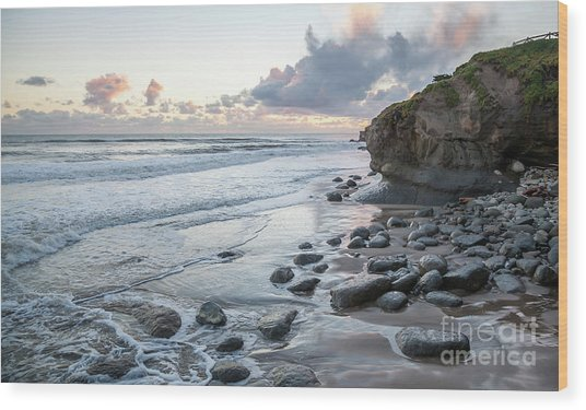 Sunset View In The Distance With Large Rocks On The Beach Wood Print