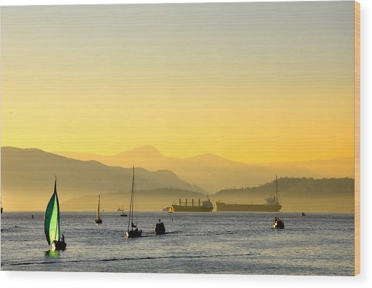 Sunset With Green Sailboat Wood Print